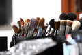 Makeup brushes, in dressing room mirror closeup Royalty Free Stock Photo
