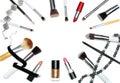 Makeup Brushes, lipsticks and nail polish isolated on white background Royalty Free Stock Photo