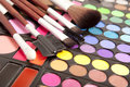 Makeup brushes and make up eye shadows Stock Photo