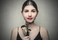 Makeup brushes portrait young woman holding make up Royalty Free Stock Photos