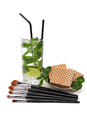 Makeup brushes set. Mojito with waffles. Isolated. White background Royalty Free Stock Photo