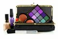Makeup collection bag with assorted cosmetics over a white background Stock Photos