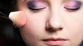 Makeup face applying rouge blusher young woman with brush Royalty Free Stock Photography