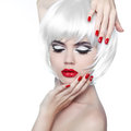 Makeup and hairstyle red lips and manicured nails fashion beau beauty girl isolated on white background Royalty Free Stock Image