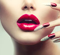 Makeup and manicure red long nails red glossy lips Stock Photos