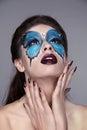 Makeup manicured nails fashion face art portrait beautiful mo model woman posing on gray background Stock Photography
