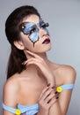 Makeup manicured nails fashion face art portrait beautiful model woman posing on gray background Stock Photography