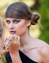 Makeup master applying lipstick with brush Royalty Free Stock Photography