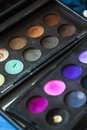 Makeup palette brushes and make up eye shadows close up selective focus Royalty Free Stock Photo