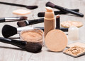 Makeup products to even out skin tone and complexion accessories round cosmetic sponge bottle of liquid foundation concealer Stock Photos
