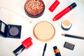 Makeup set of smokey eyes eyeshadow palette, brow powder, primer, eye pencils and lipsticks Royalty Free Stock Photo