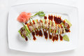 Maki sushi on plate isolated on white the Stock Image