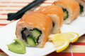 Maki sushi roll made of smoked eel cream cheese and deep fried vegetables inside fresh salmon outside Royalty Free Stock Images