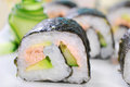 Maki sushi rolls with salmon and avocado japanese cucumber fresh Royalty Free Stock Photos