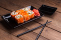 Maki sushi on wooden background Royalty Free Stock Photo