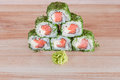 Maki sushi on wooden background roll a Stock Images