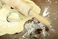 Making biscuits rolling pin on dough and molds for Stock Images