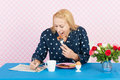 Making the crossword puzzle s in the morning mature woman newspapers while having breakfast Stock Photos