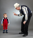 Making discipline grandfather trying to his naughty grandson Royalty Free Stock Photos