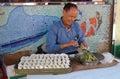 Smiling Man Making Chinese Dumplings, Cheung Chau, Hong Kong Royalty Free Stock Photo
