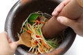 Making of green papaya salad som tam thai food ingredients are mixing and pounding in a mortar Stock Photos