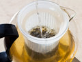 Making green tee in glass teapot with boiling water Royalty Free Stock Photo