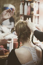 Making hair braids in hair studio Royalty Free Stock Photo