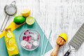 Making lemonade. Cookware, fruits, bottle of lemonade and ice cubes on wooden table background top view copyspace