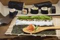 Making maki sushi rolls Royalty Free Stock Photo