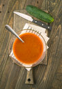 Making overhead vegetarian soup in glass bowl on wood Royalty Free Stock Photo