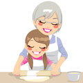 Making pizza dough together granddaughter and grandmother handmade using rolling pin Stock Image
