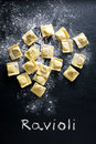 Making ravioli pasta and flour on black background Royalty Free Stock Photo