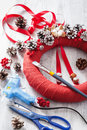 Making red christmas wreath decoration diy handmade Royalty Free Stock Photo