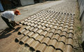 Making roof tile worker drying a in solo central java indonesia Stock Photo