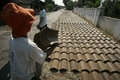 Making roof tile worker drying a in solo central java indonesia Royalty Free Stock Photography