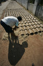 Making roof tile worker drying a in solo central java indonesia Stock Image