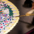Making sand mandala a spiritual and ritual symbol in hinduism and buddhism by tibetan monk Stock Photos