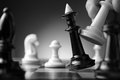 Making a strategic move conceptual image depicting with hand moving chess piece on chessboard during game of skill Royalty Free Stock Images