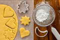 Making sugar cookies with cookie cutters Stock Images