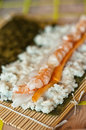 Making sushi closeup of traditional japanese being made on bamboo mat Royalty Free Stock Photos