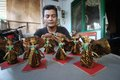 Making traditional action figure worker solo batik carnival in solo central java indonesia Stock Image