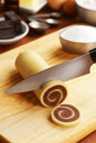 Making vanilla and chocolate pinwheel cookies are being made the two flavors of dough have been spiraled together chilled now a Royalty Free Stock Photos