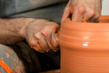 Making of the vase from fresh clay craftsman wet on pottery wheel Stock Photo