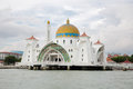 Malacca straits mosque malaysia circa january is also known as s floating as it is built on stilts above Stock Images