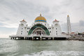 Malacca straits mosque malaysia circa january is also known as s floating as it is built on stilts above Stock Photography