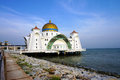 The malacca straits mosque on man made island off coast of town in malaysia Royalty Free Stock Photos
