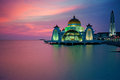 Malacca straits mosque during sunset the malay masjid selat melaka is a located on the man made island near town in Stock Photography