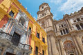 Malaga cathedral tower and the baroque facade of bishops p palace Royalty Free Stock Photo