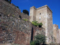 Malaga city walls spain with blue skyline fortification brick in in a sunny day a sky Royalty Free Stock Images