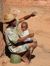 Malagasy woman with her baby Royalty Free Stock Photo